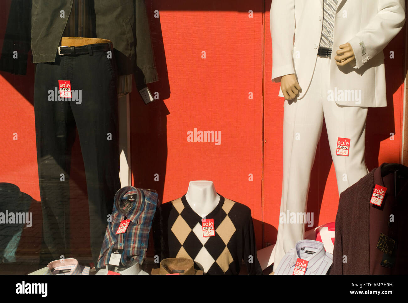 997939ea8 dummies in old style mens clothes shop window selling Pringle sweaters and  slacks - Stock Image