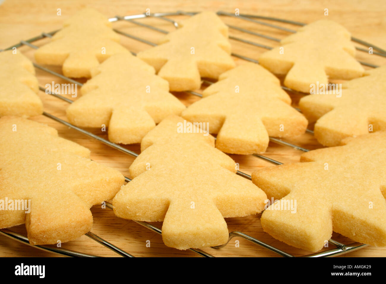 Christmas Tree Shaped Biscuits On A Cooling Rack Stock Photo