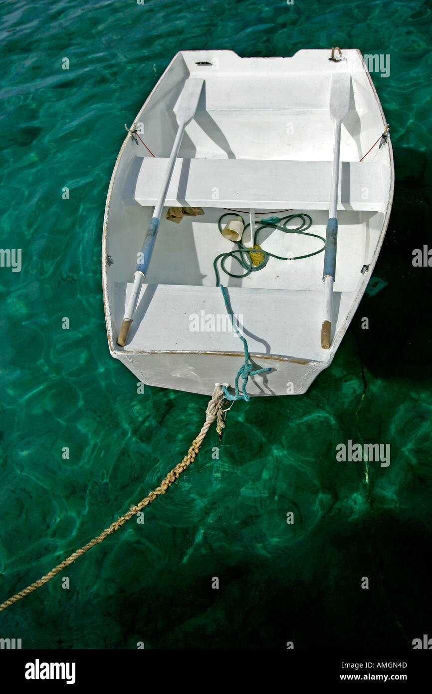White rowing boat tied up Gustavia Harbour St Barts - Stock Image