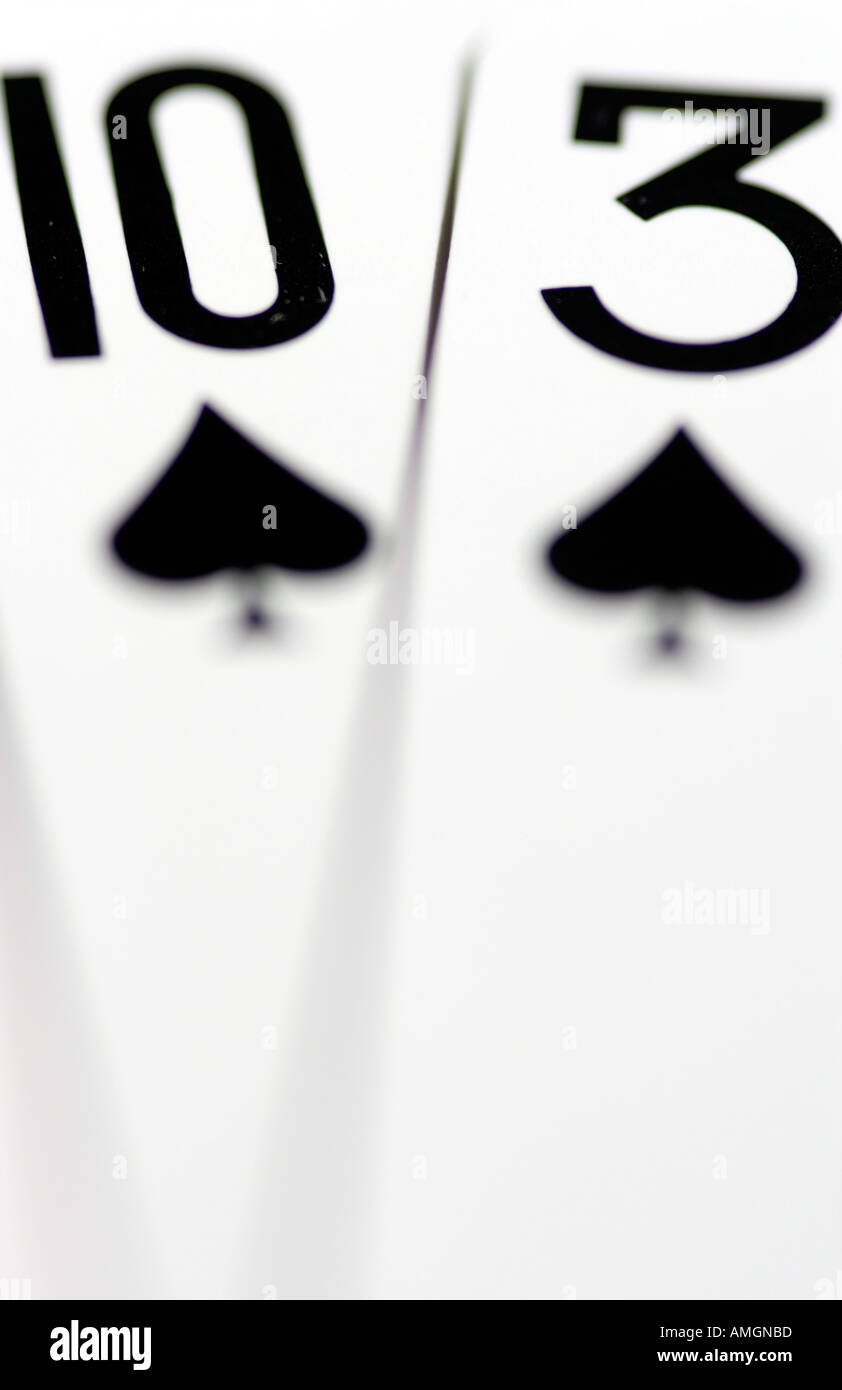 Close up of playing cards adding up to Unlucky number 13 thirteen - Stock Image