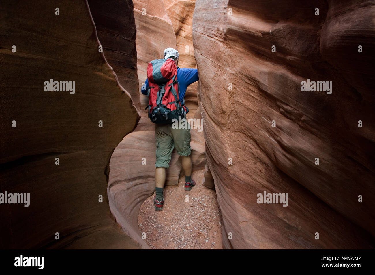 Hiker in Peek a Boo slot canyon near Escalante in Grand Staircase National Monument Utah USA Stock Photo