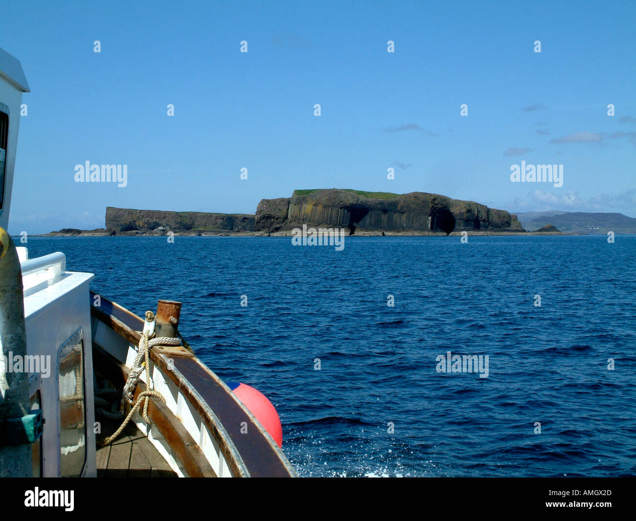 Approaching the island of Staffa viewed from a boat Scotland UK - Stock Image