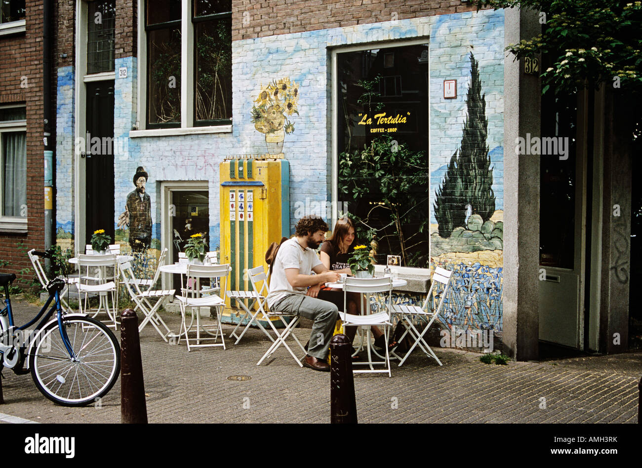 People Seated At Outdoor Cafe Table Outside La Tertulia Coffee Shop Amsterdam Holland