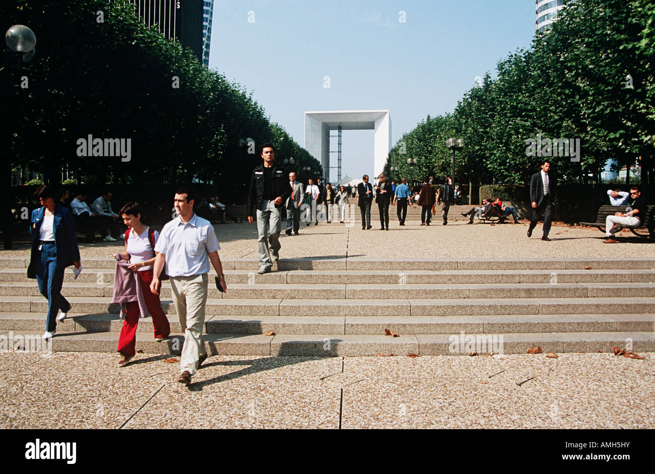 People walking near La Grande Arche de la Defense, Paris, France Stock Photo