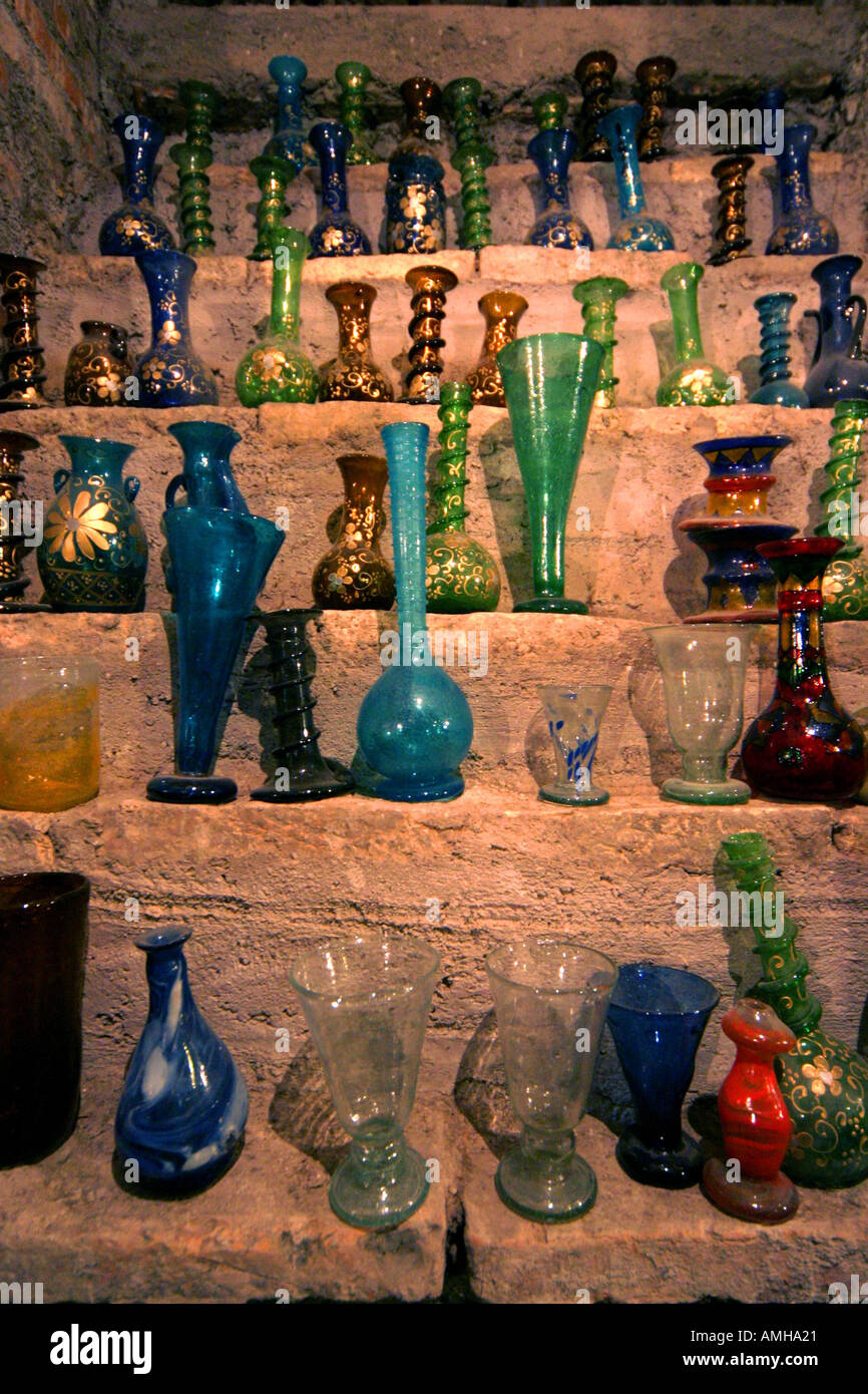 An old cellar with glass objects in a shop in Rome Italy - Stock Image