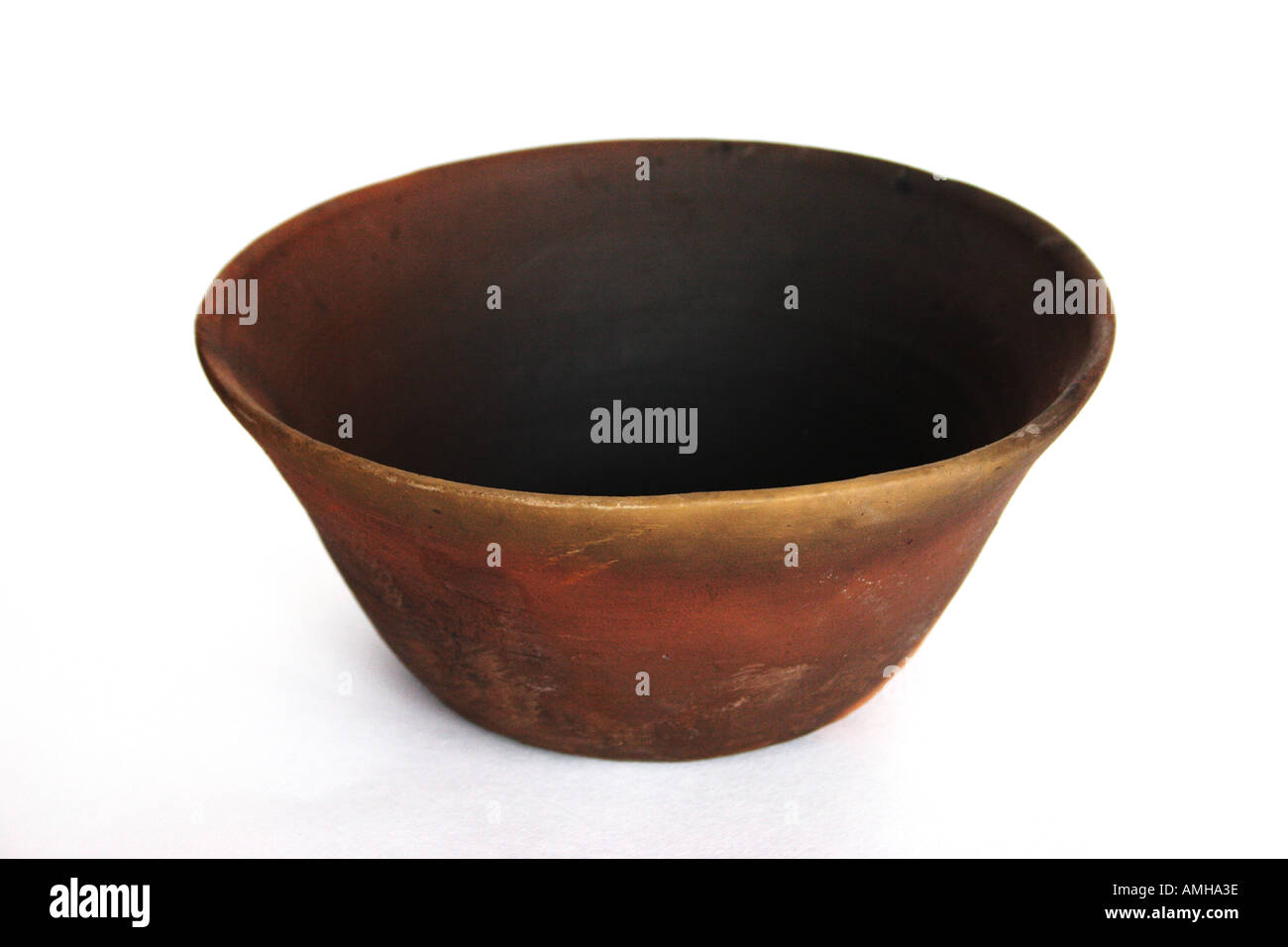 Terracotta bowl with a white background - Stock Image