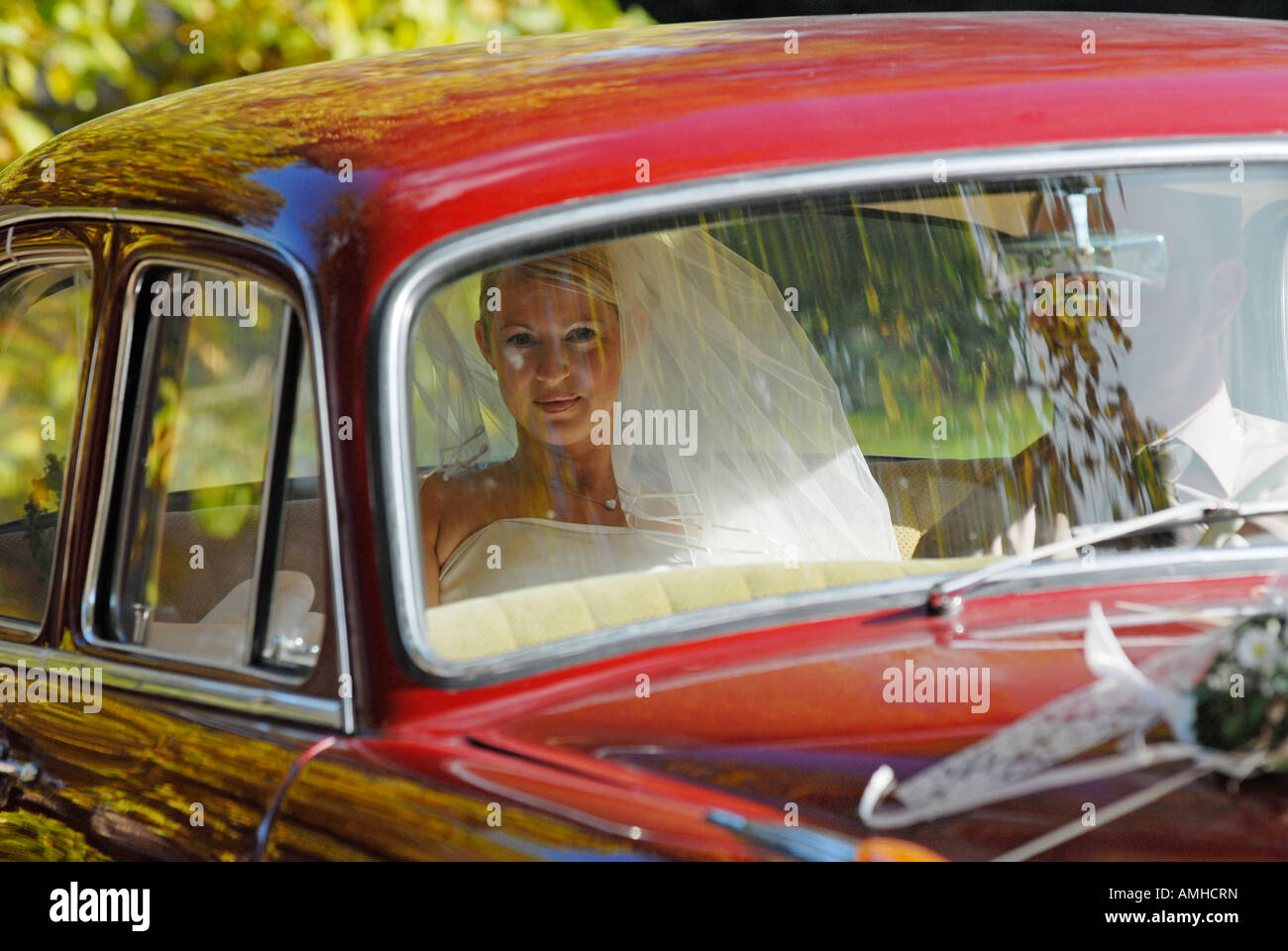 Bride in the wedding car on the way to church Stock Photo