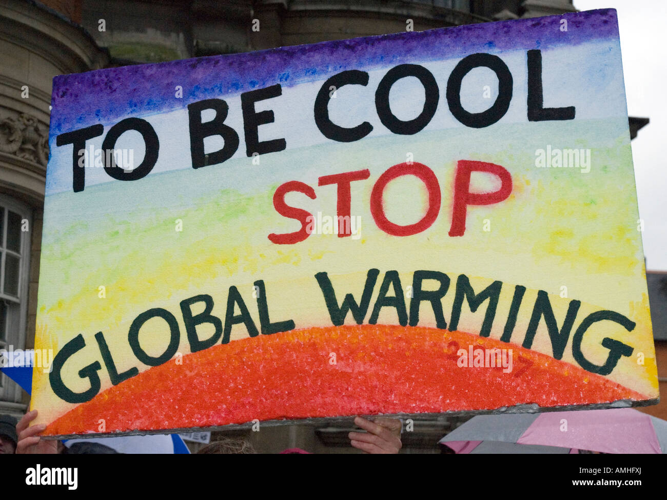 'To Be Cool Stop Global Warming' protestor s placard Climate Change march London December 8th 2007 - Stock Image