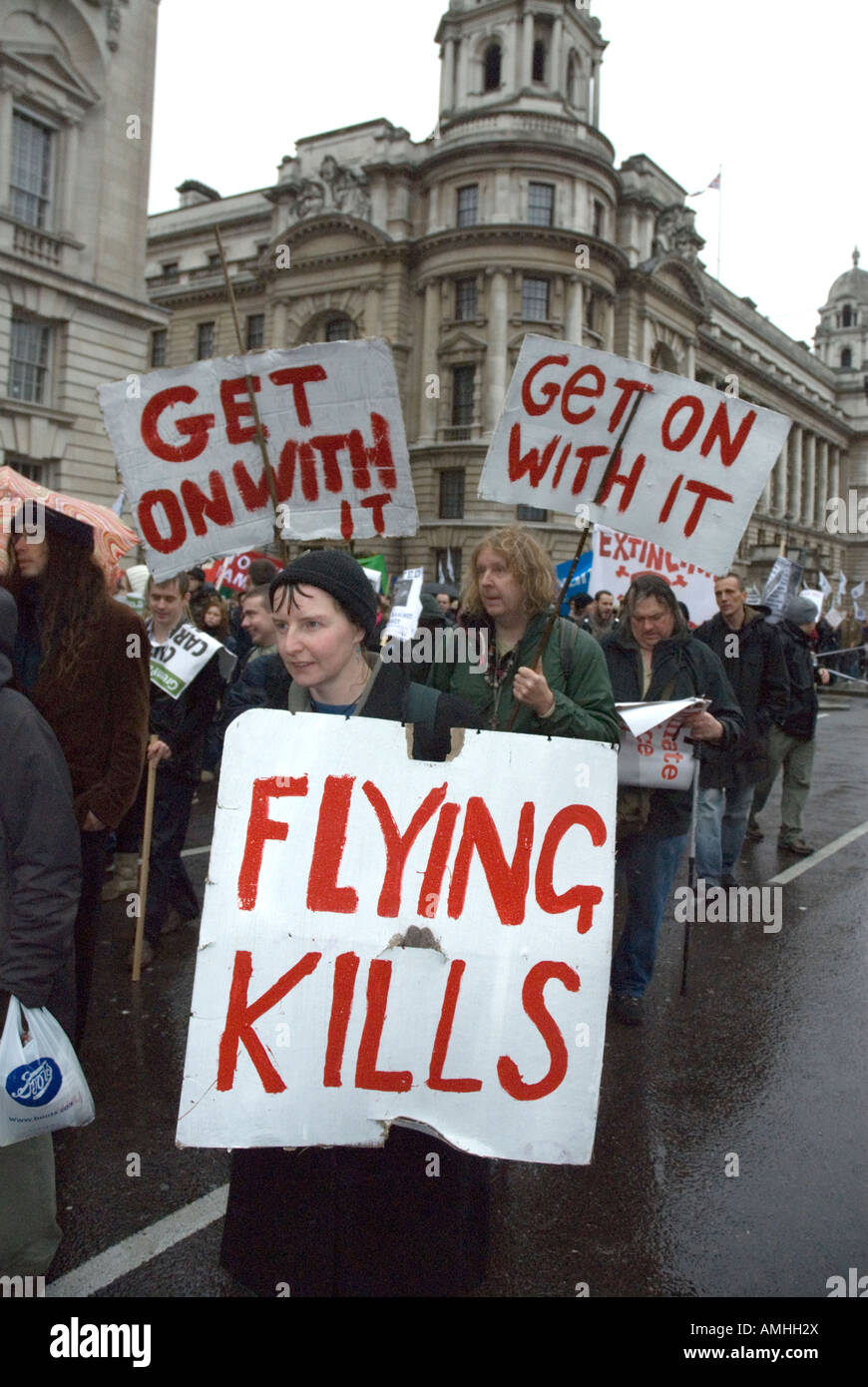 Flying Kills protestors placards Climate Change march London December 8th 2007 Stock Photo