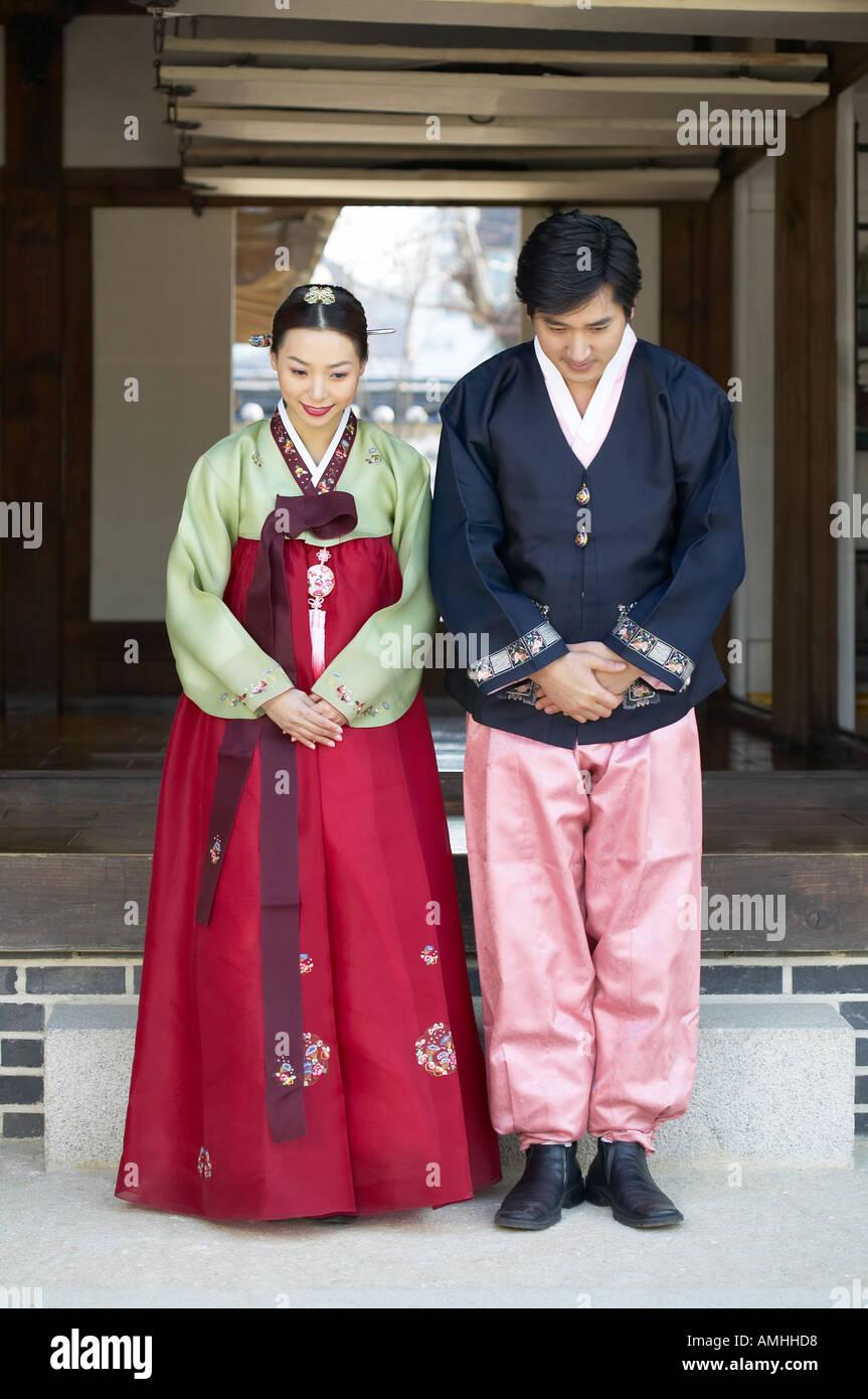 A couple in hanbok greet in korean way stock photo 4984279 alamy a couple in hanbok greet in korean way m4hsunfo