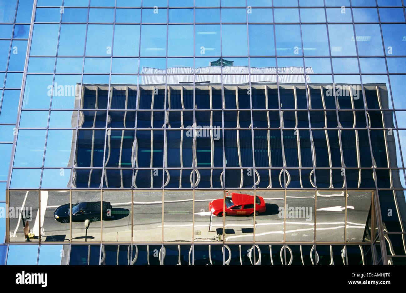 Street scene reflected in building window Montreal Quebec Canada Stock Photo