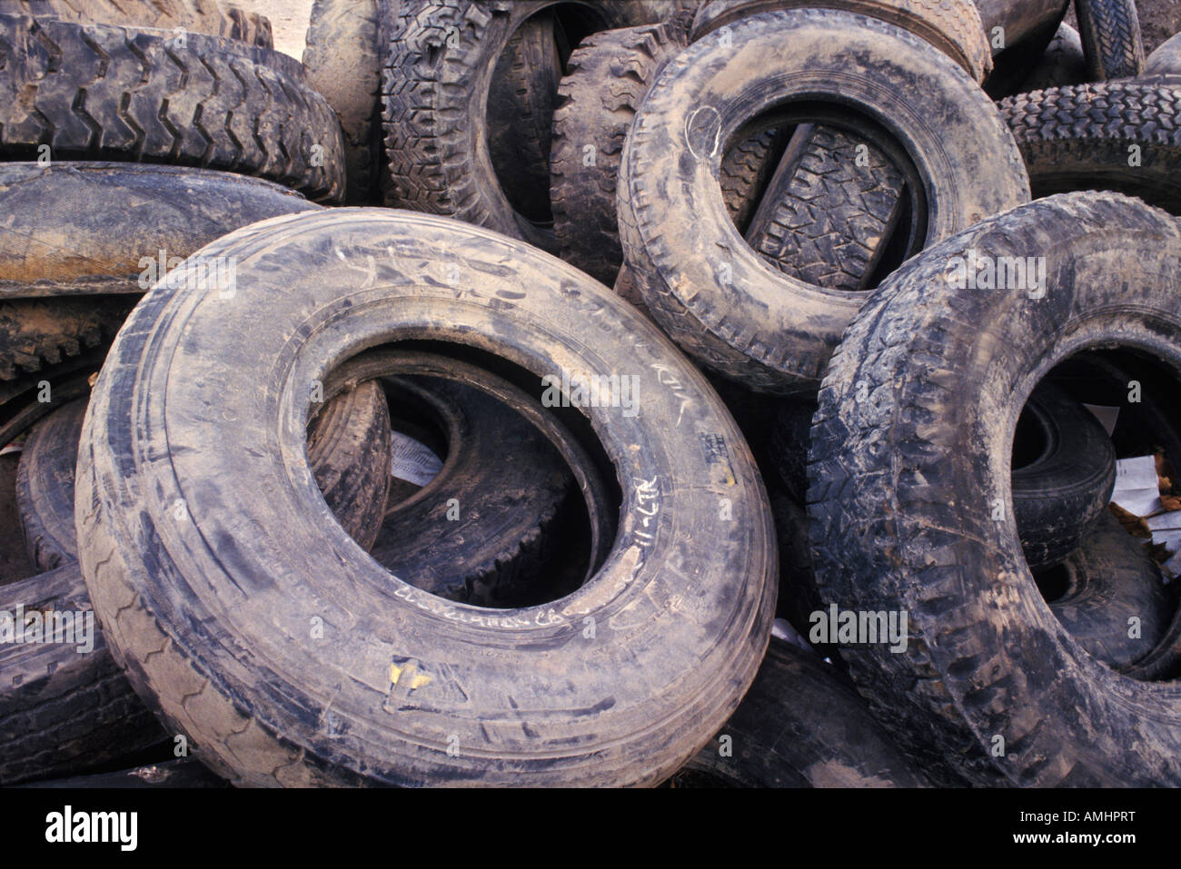 A pile of truck & auto tires waiting to be recycled - Stock Image
