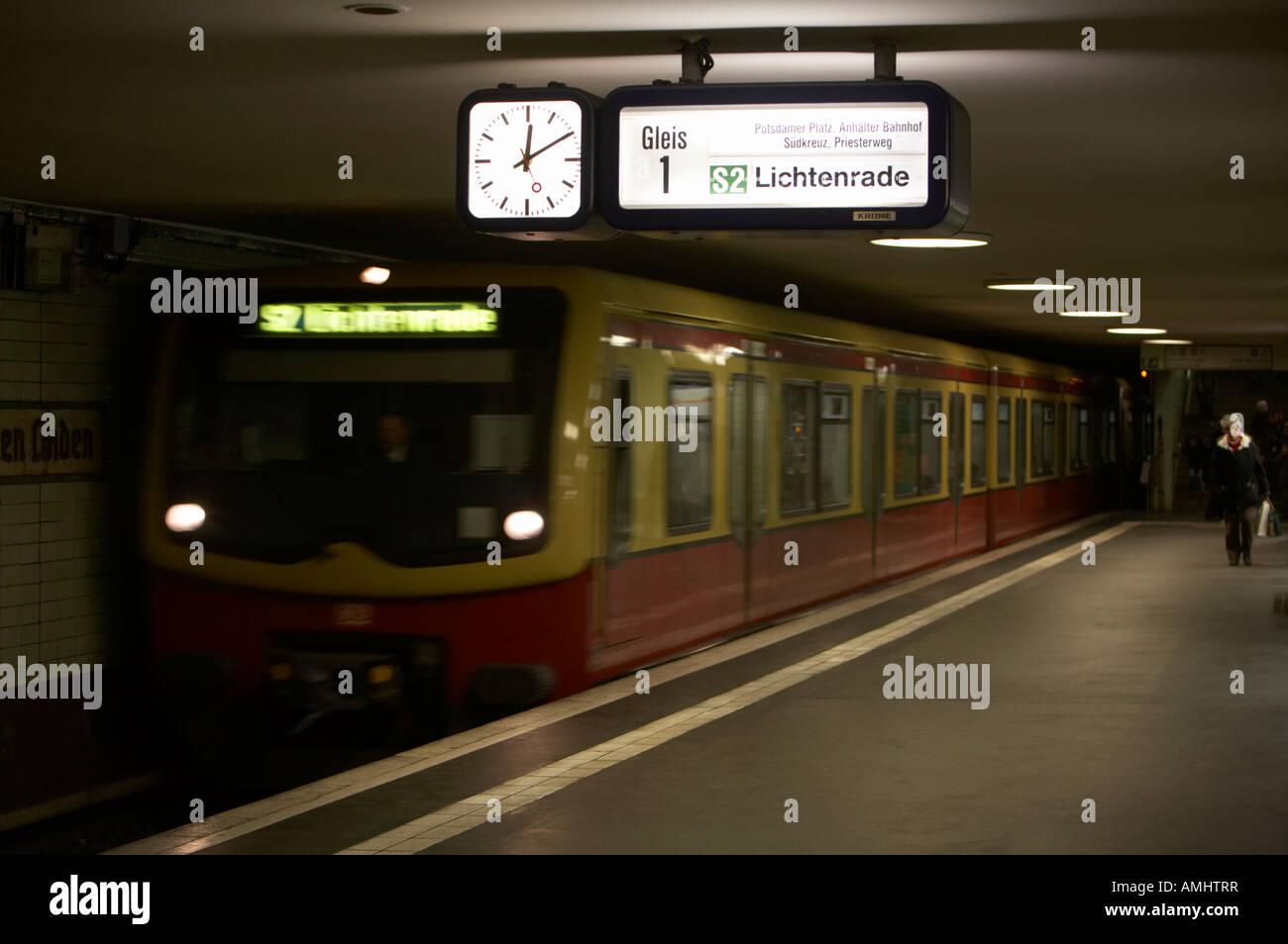 s bahn train speeding through unter den linden underground station Berlin Germany Stock Photo
