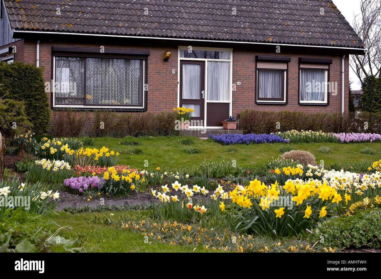 Dutch House With Flower Garden