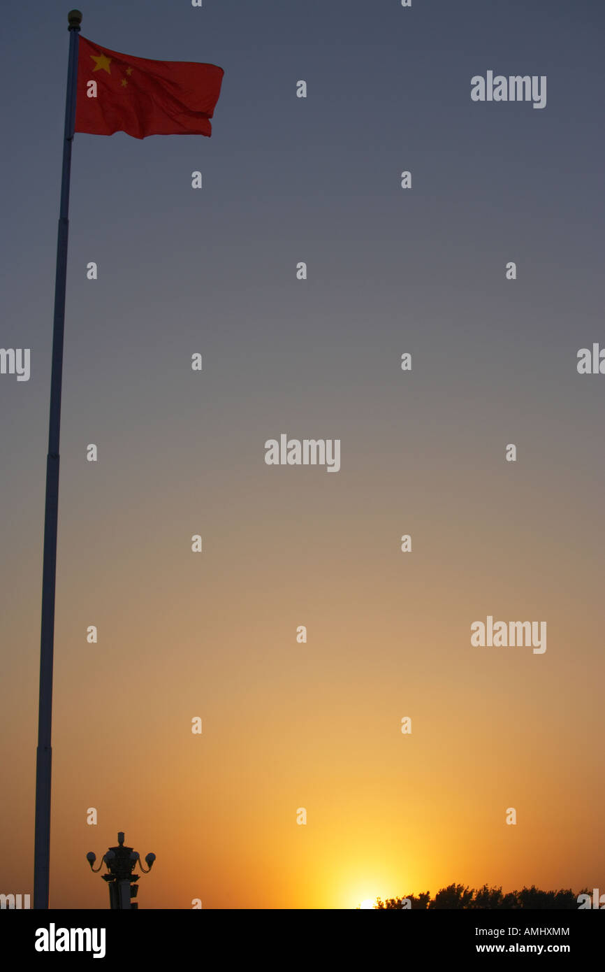 Chinese flag at sunset from Tiananmen Square Beijing China - Stock Image