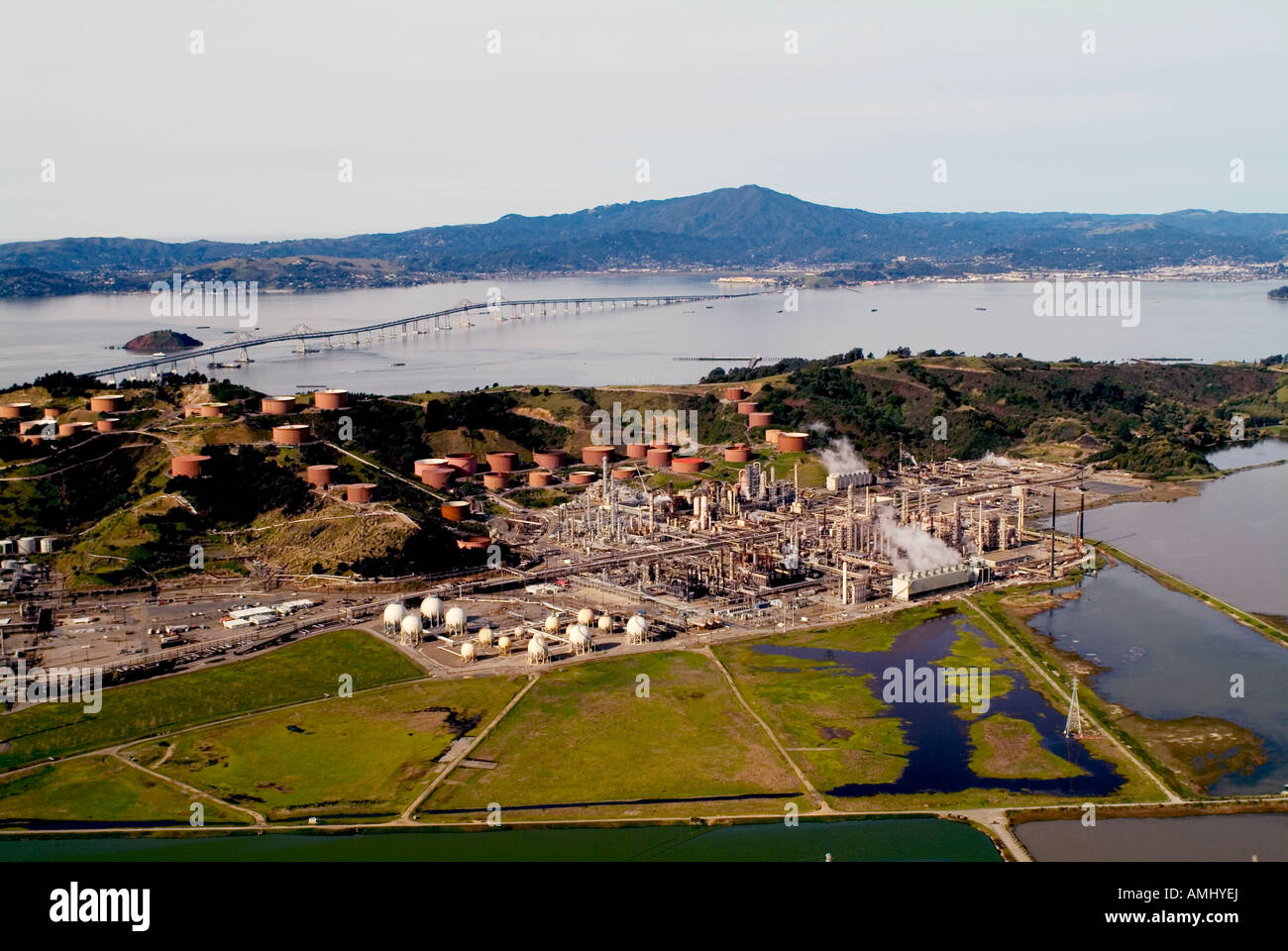 aerial above Chevron Refinery Richmond California Mount Tamalpais in background San Francisco bay Stock Photo