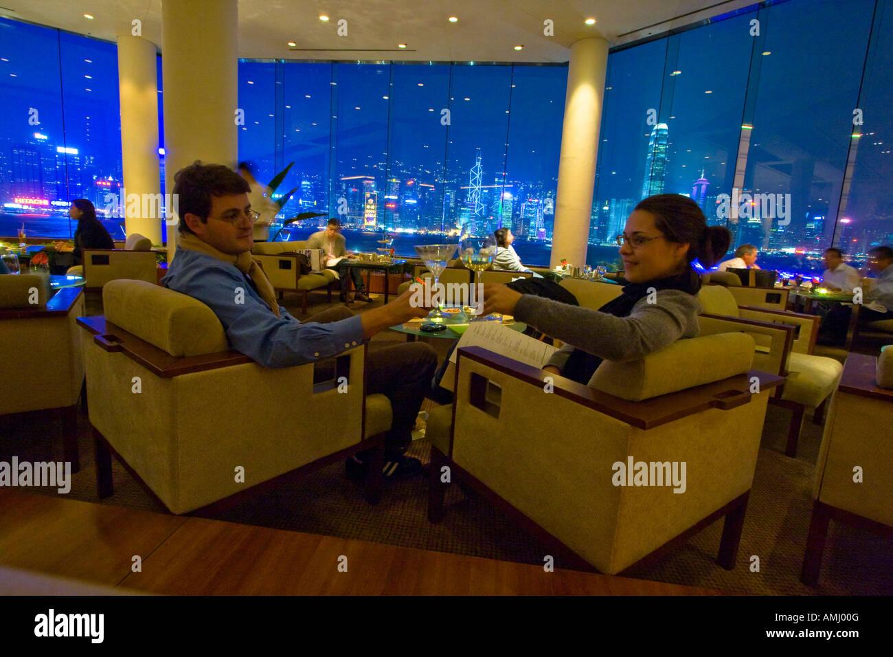 Toasting at he Lobby Lounge Bar at the Intercontinental Hotel Hong Kong - Stock Image