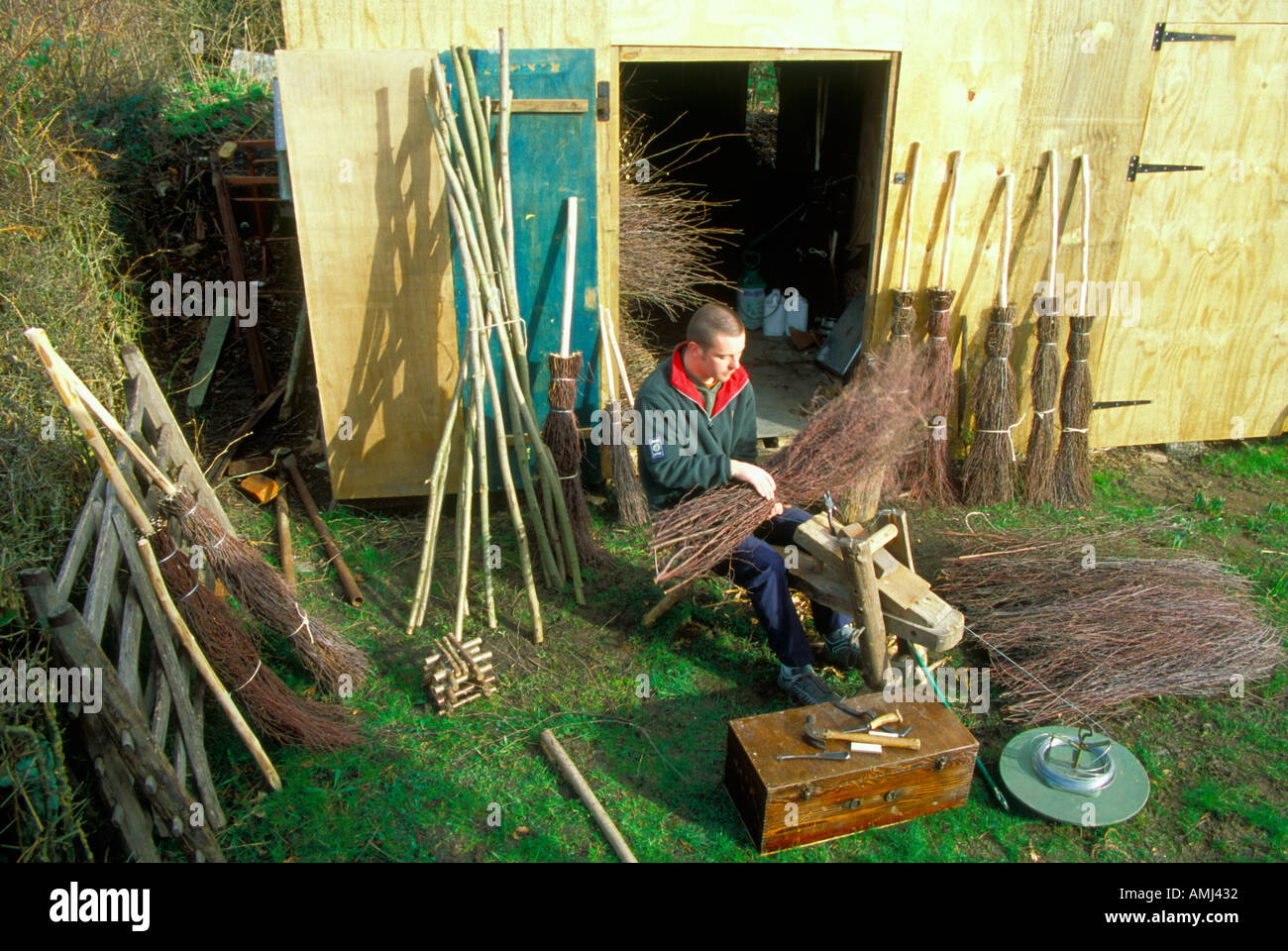 Adam King making the traditional besom brooms in the same way as his family have done for many years at High Wycombe - Stock Image