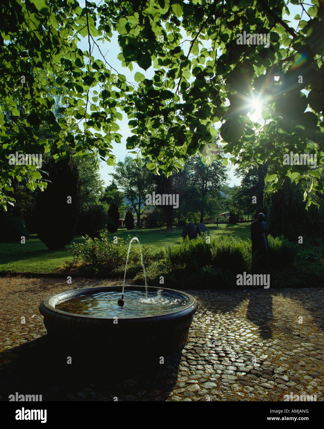 May 2000 Switzerland Zofingen Fountain in garden sunrise - Stock Image