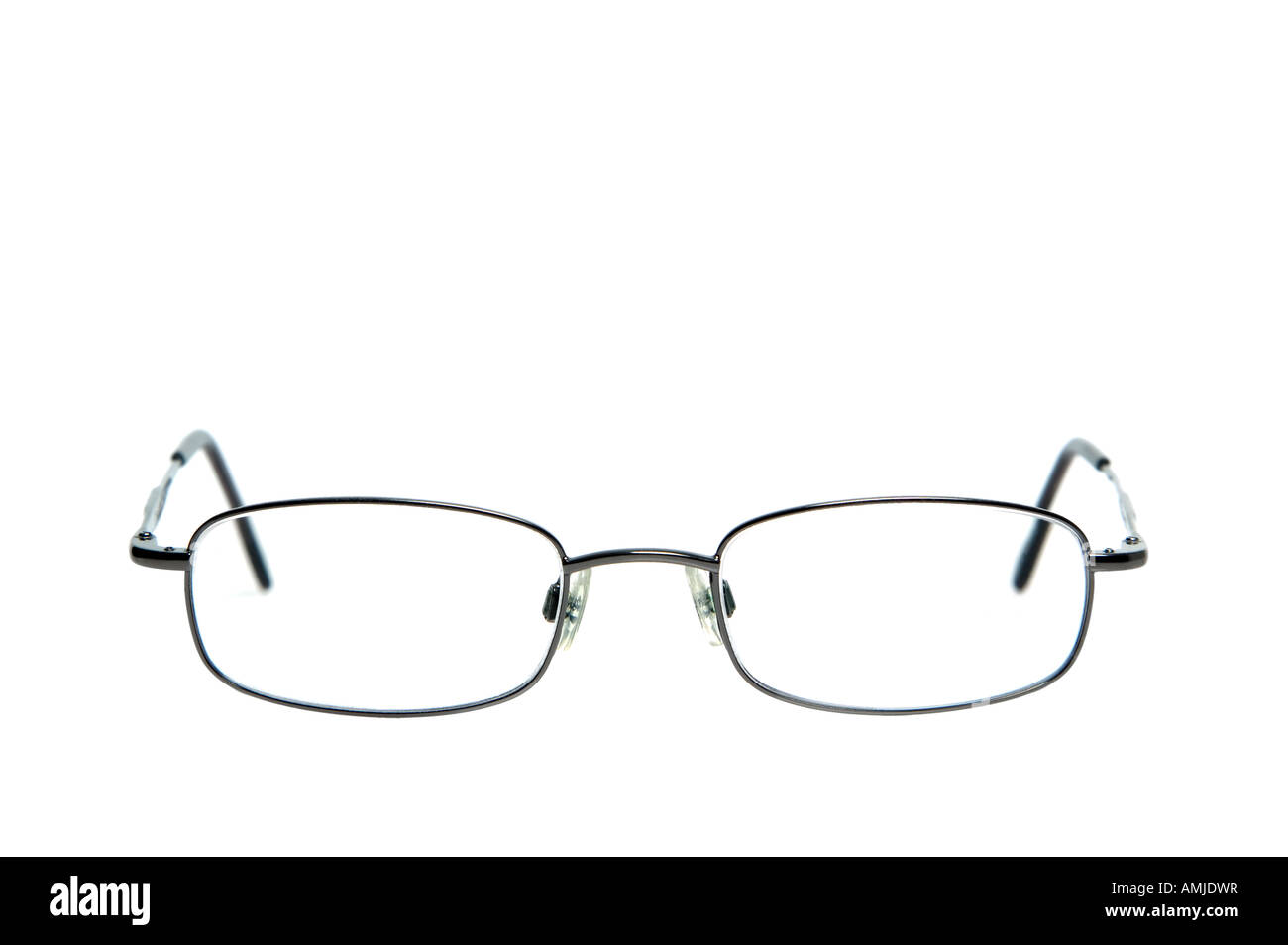 Pair of spectacles against a white background shallow DOF - Stock Image