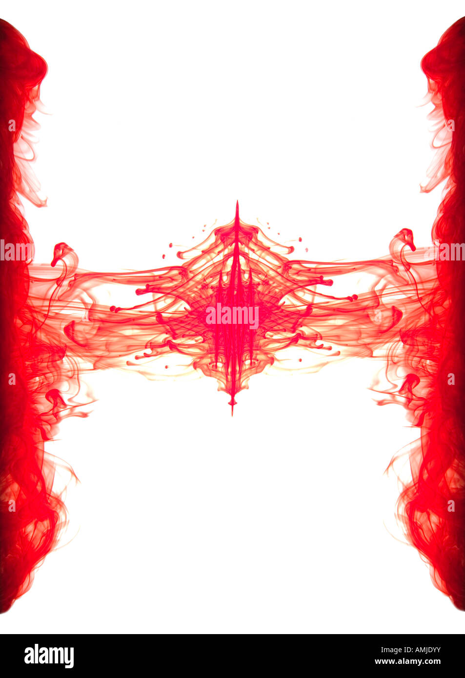 Abstract image of red ink forming shapes in water - Stock Image