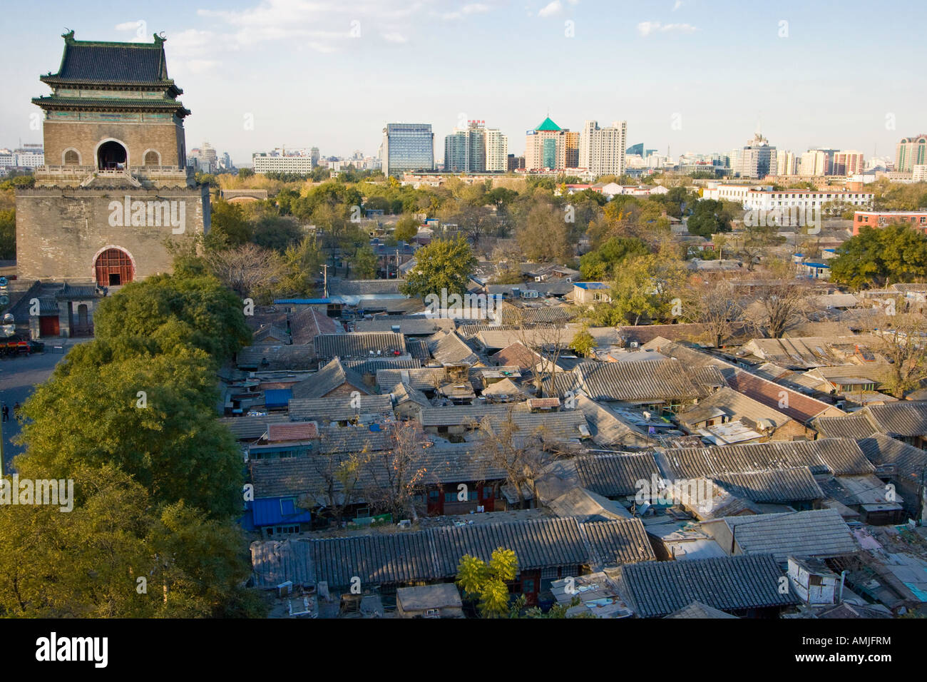 The Bell Tower and Rooftops of Surrounding Hutong Beijing China - Stock Image