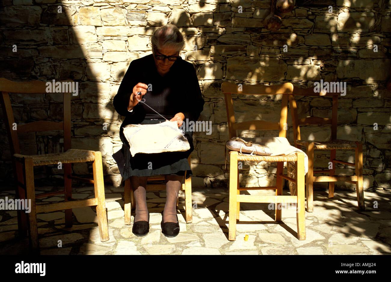 Cyprus old woman doing needlework - Stock Image