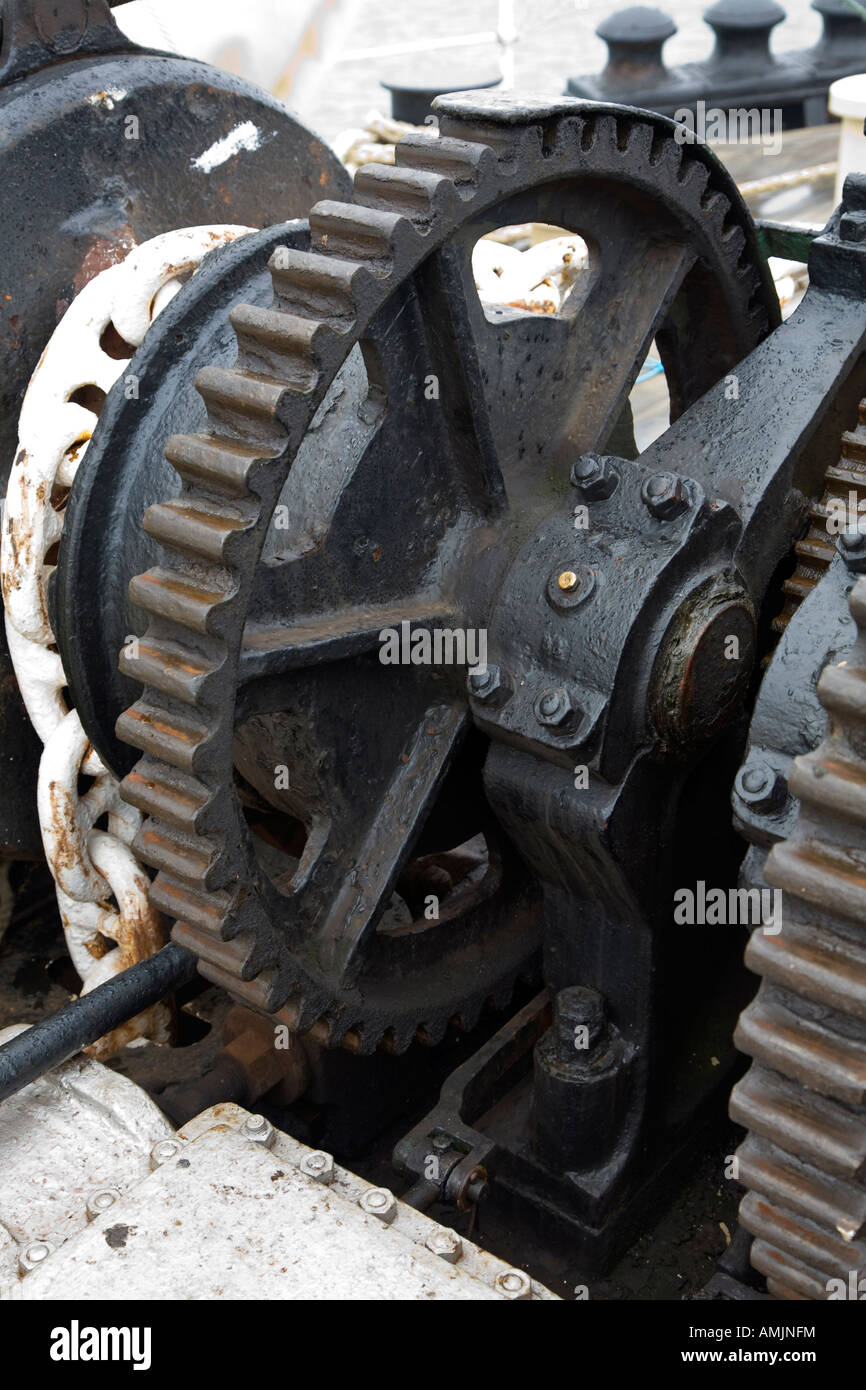 greased old winch gear wheel showing cog teeth - Stock Image