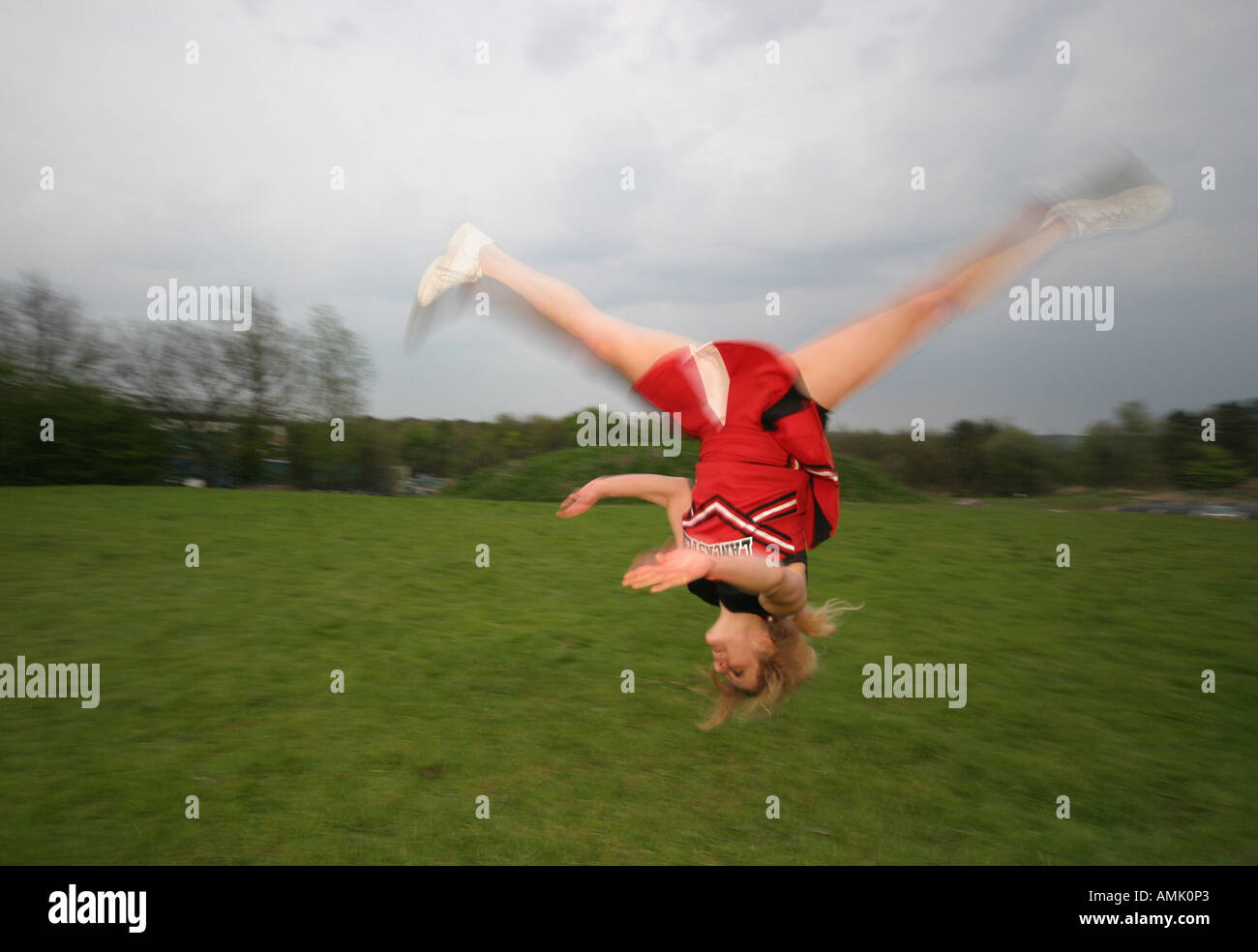 cheerleader doing a summersault - Stock Image