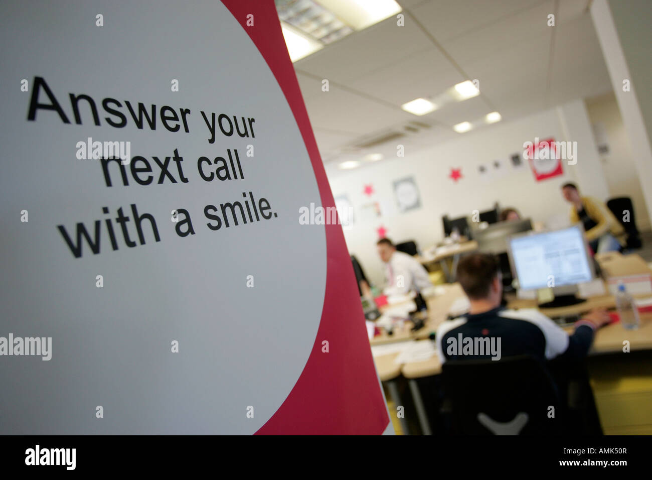 AN INSPIRATIONAL SIGN IN A CALL CENTRE. - Stock Image