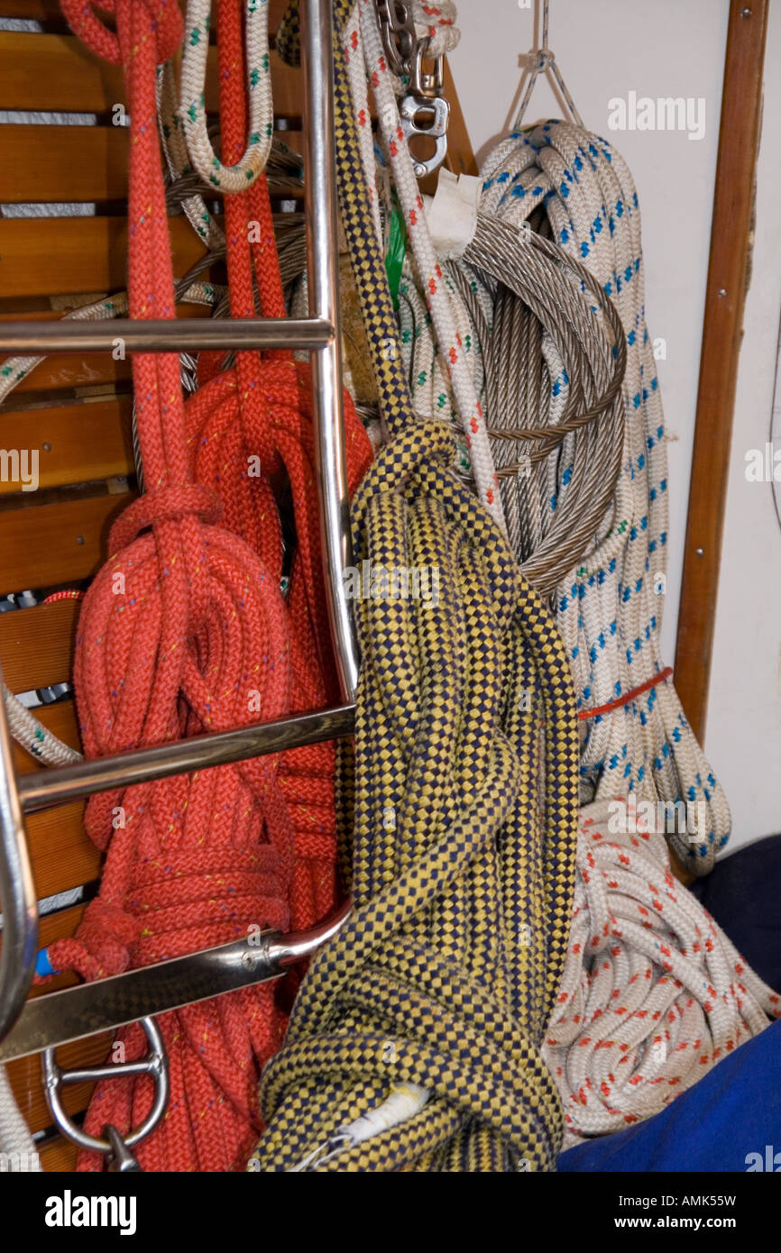Coloured nylon ropes hanging below deck on the Alba Explorer berthed in Dundee,UK - Stock Image