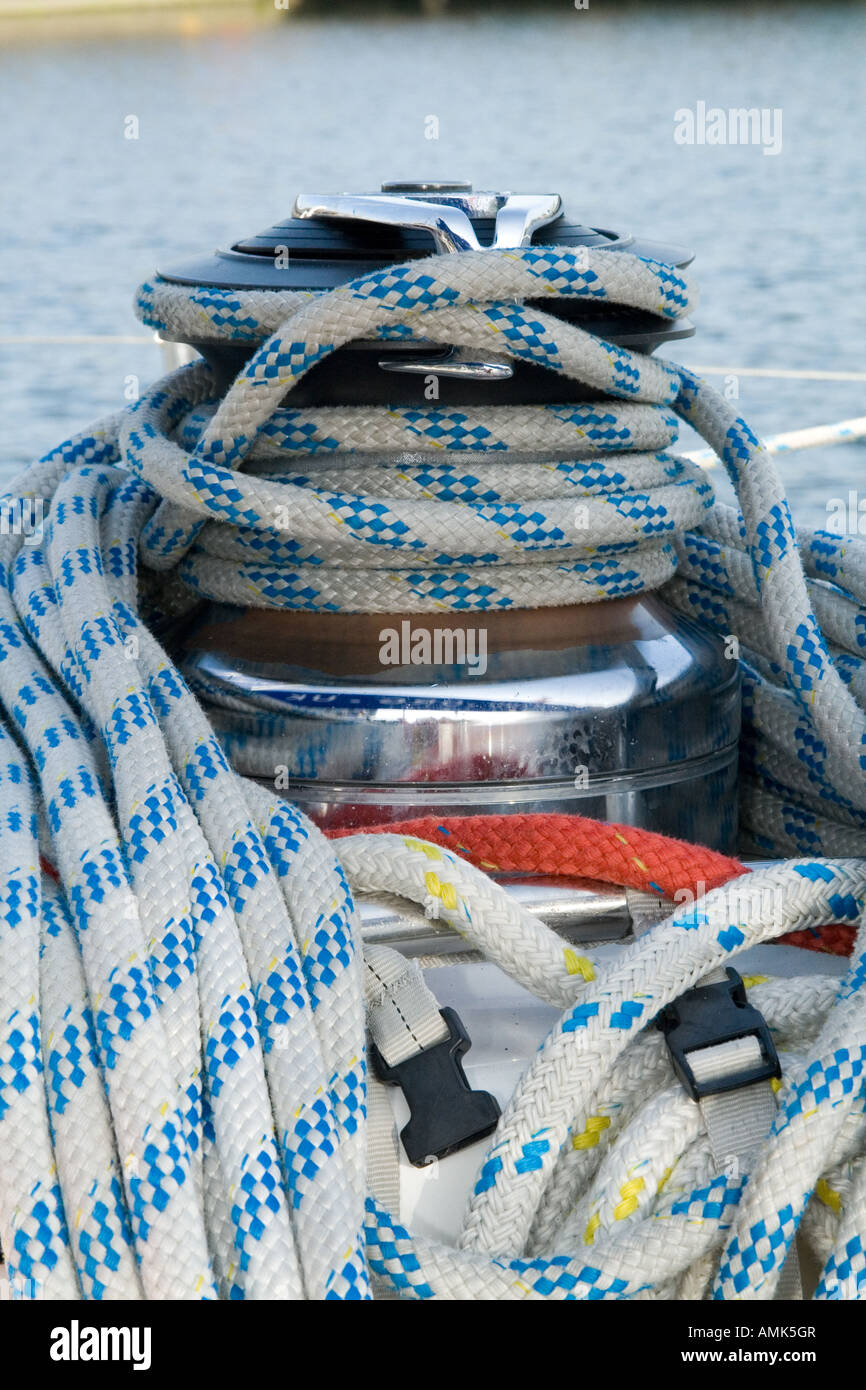 Closeup of nylon ropes wrapped around the capstan on the Alba Explorer sailing yacht in Dundee,UK - Stock Image