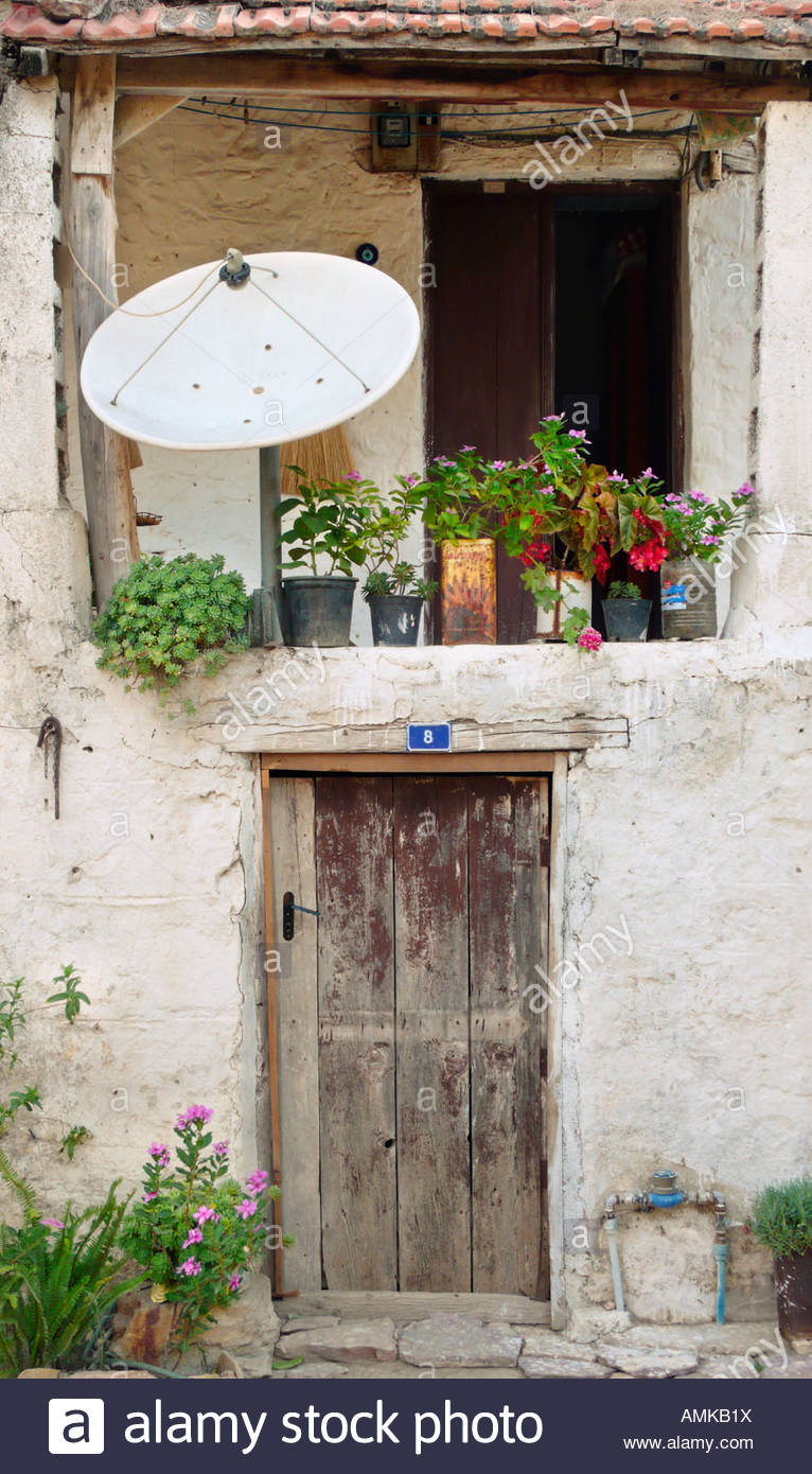 Satellite dish on rural home. (Datça, Turkey) Stock Photo