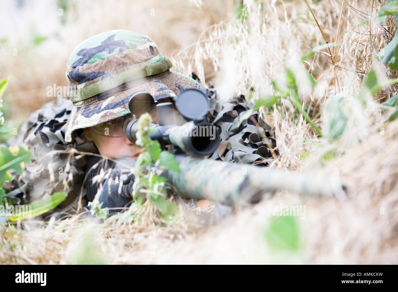 SORT, prison SWAT team, sniper in position observing a target. SORT typically handle very serious situations such - Stock Image