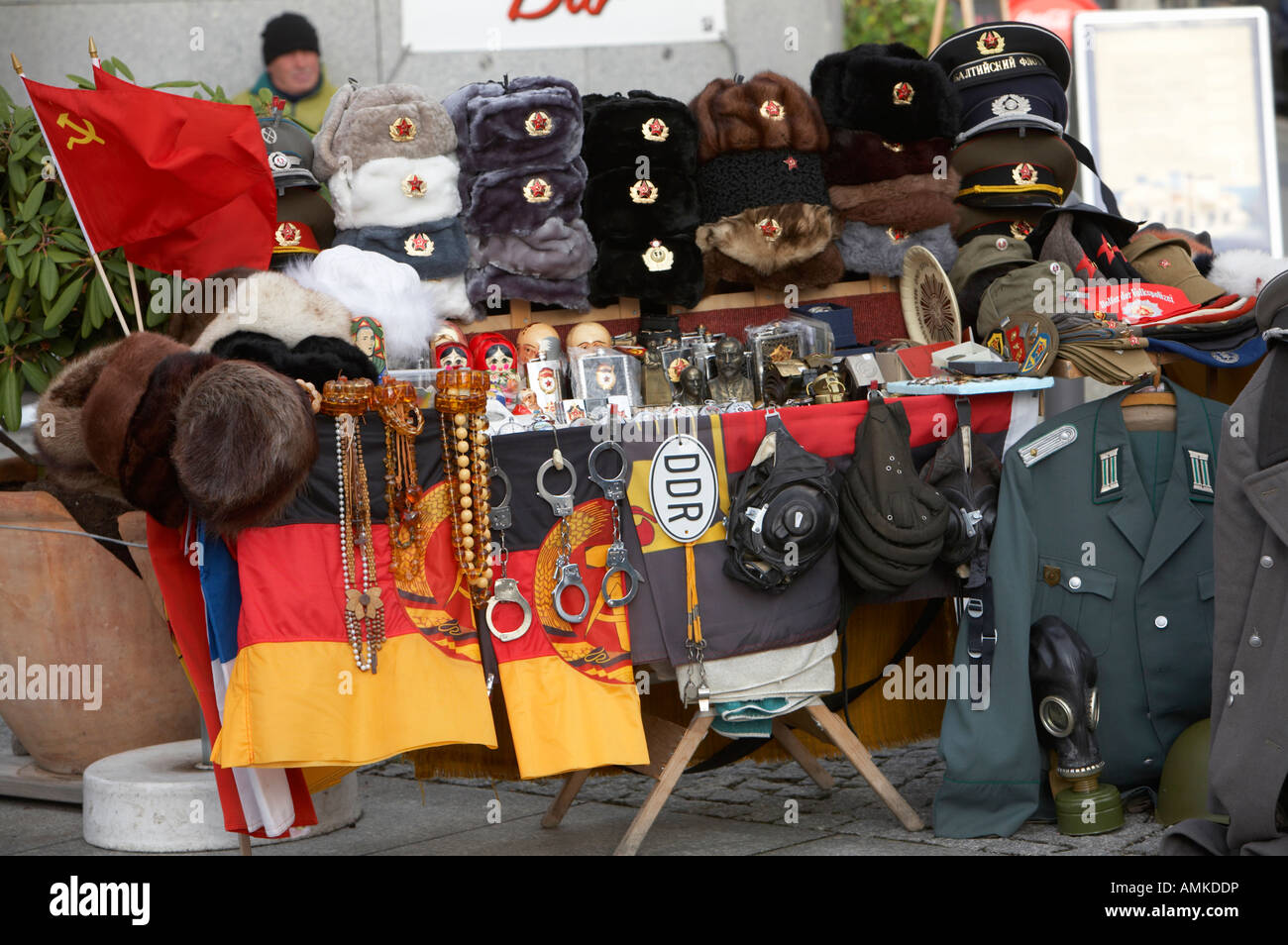 east german and russian memorabilia on sale at a street stall near checkpoint charlie Berlin Germany - Stock Image