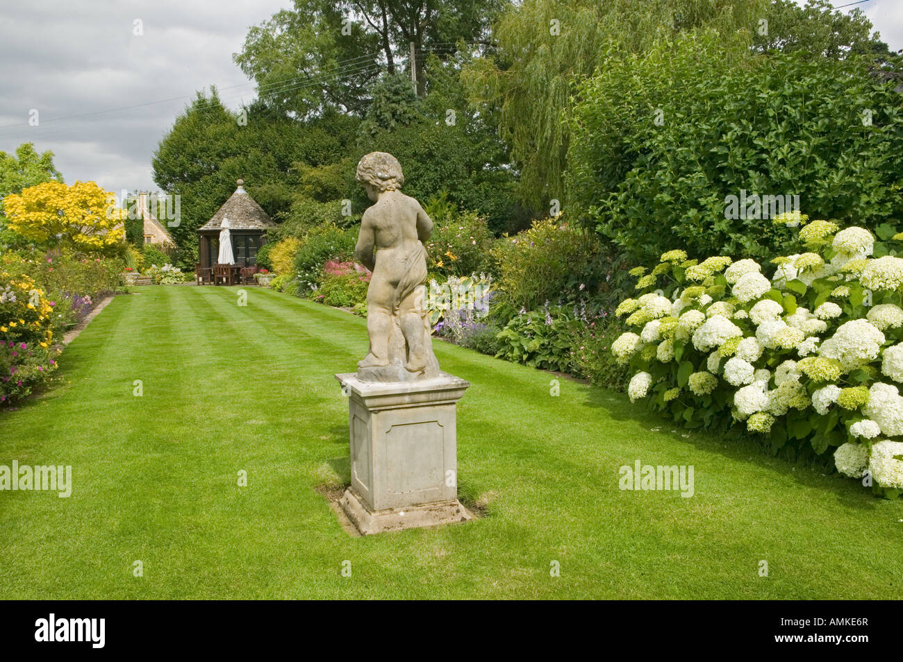 Lawn with statue - Stock Image