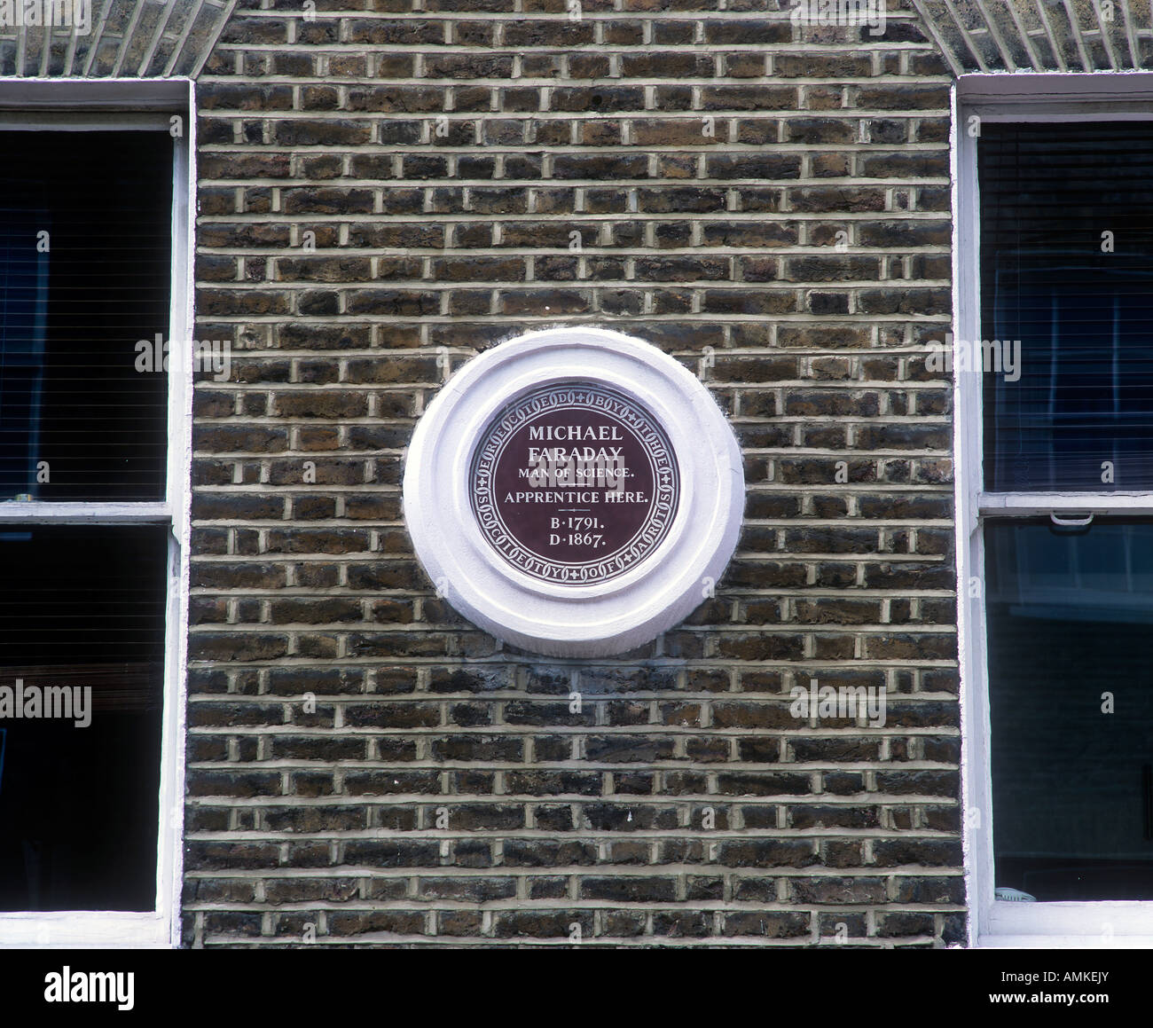 Commemorative sign for Michael Faraday on the wall of 48 Blandford St Marylebone, London W1, where he was once an - Stock Image
