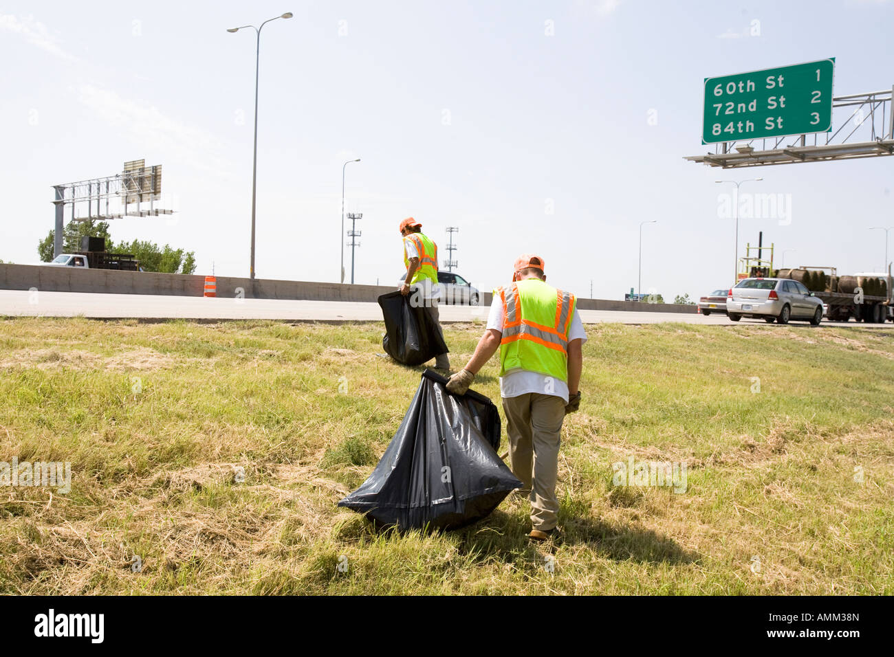Work release inmates working with picking up trash on the side of the road. Omaha, Nebraska. - Stock Image