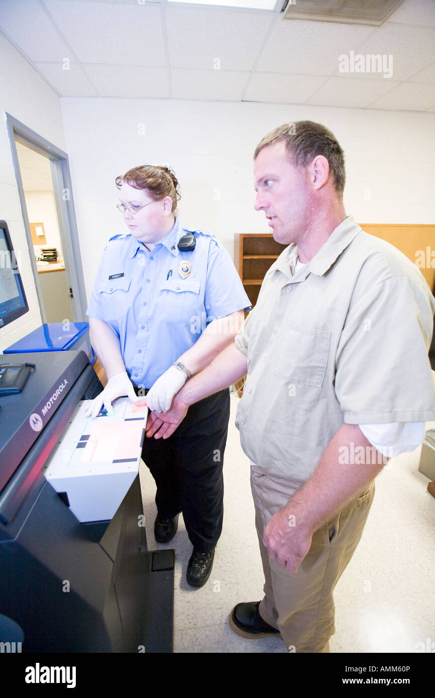 Inmate having his fingerprints digitially scanned as part of the intake process. Diagnostic and Evaluation Center, - Stock Image