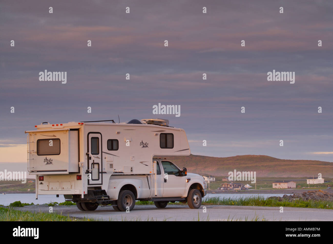 Hicker Camper parked at the end of the peninsula, L'Anse aux Meadows at sunset, Northern Peninsula, Newfoundland, - Stock Image