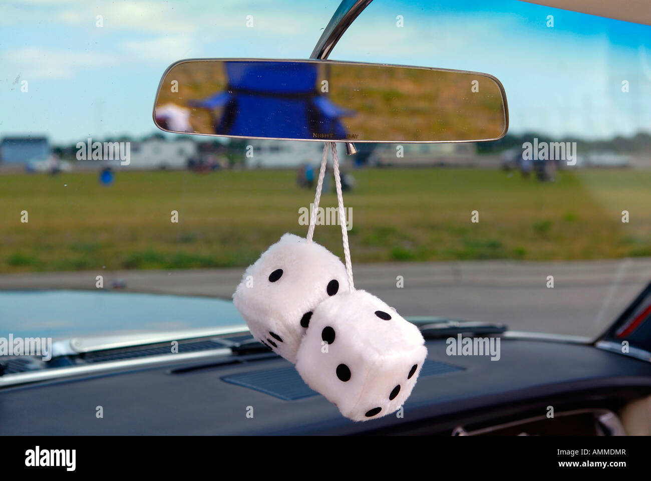 Decorative Cotton Dice Hanging On The Rear View Mirror Of 1950 S Car