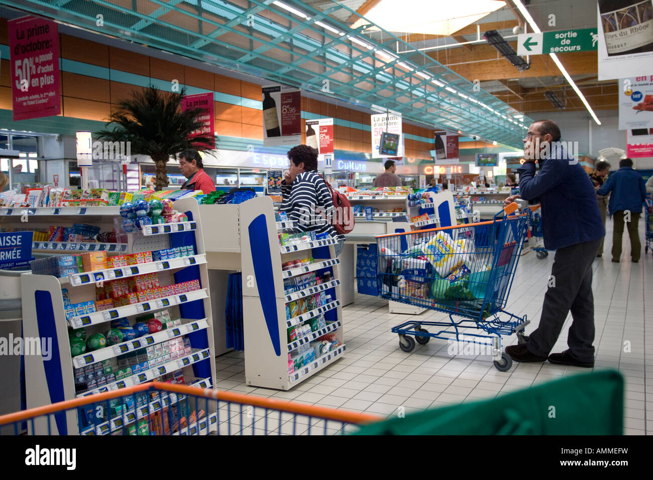 Customers waiting at checkout E Leclerc superstore Le Havre