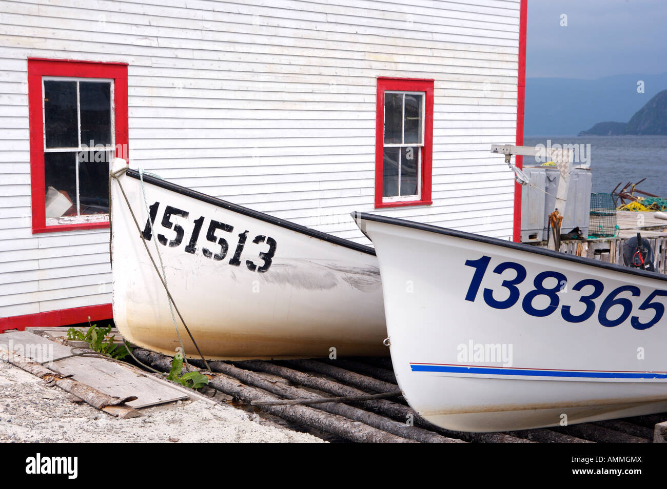 Boats hauled out beside the Roberts Store a Historic Property in Woody Point, Newfoundland Labrador, Canada. - Stock Image