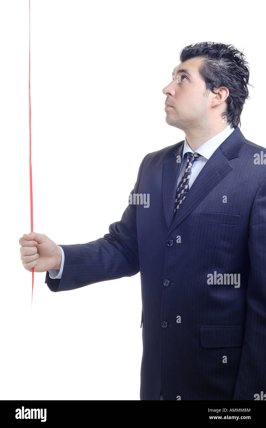 Man holding a red string in his hand - Stock Image