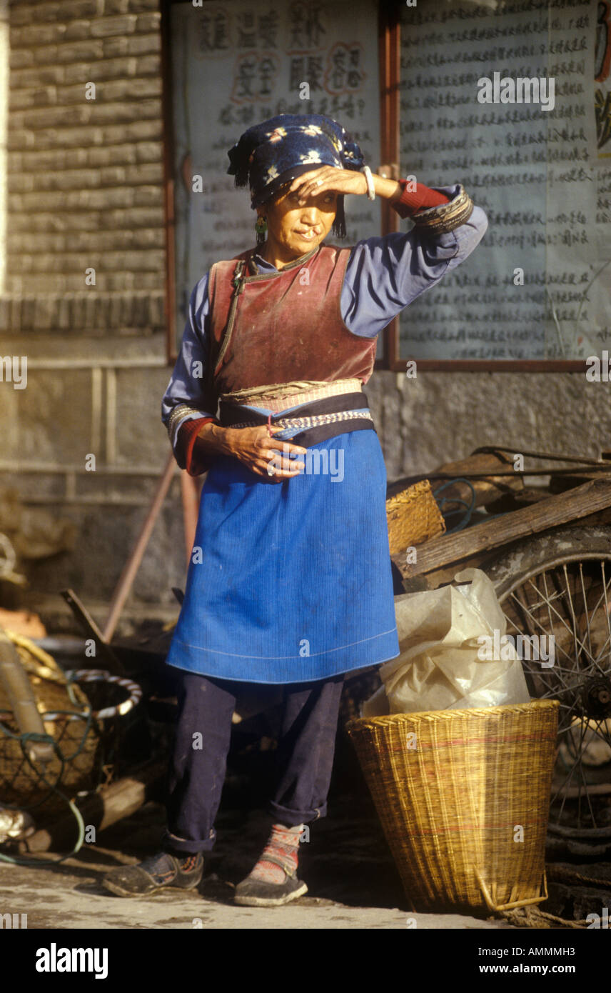 Peasant woman searching in Dali Yunnan Province People s Republic of China - Stock Image