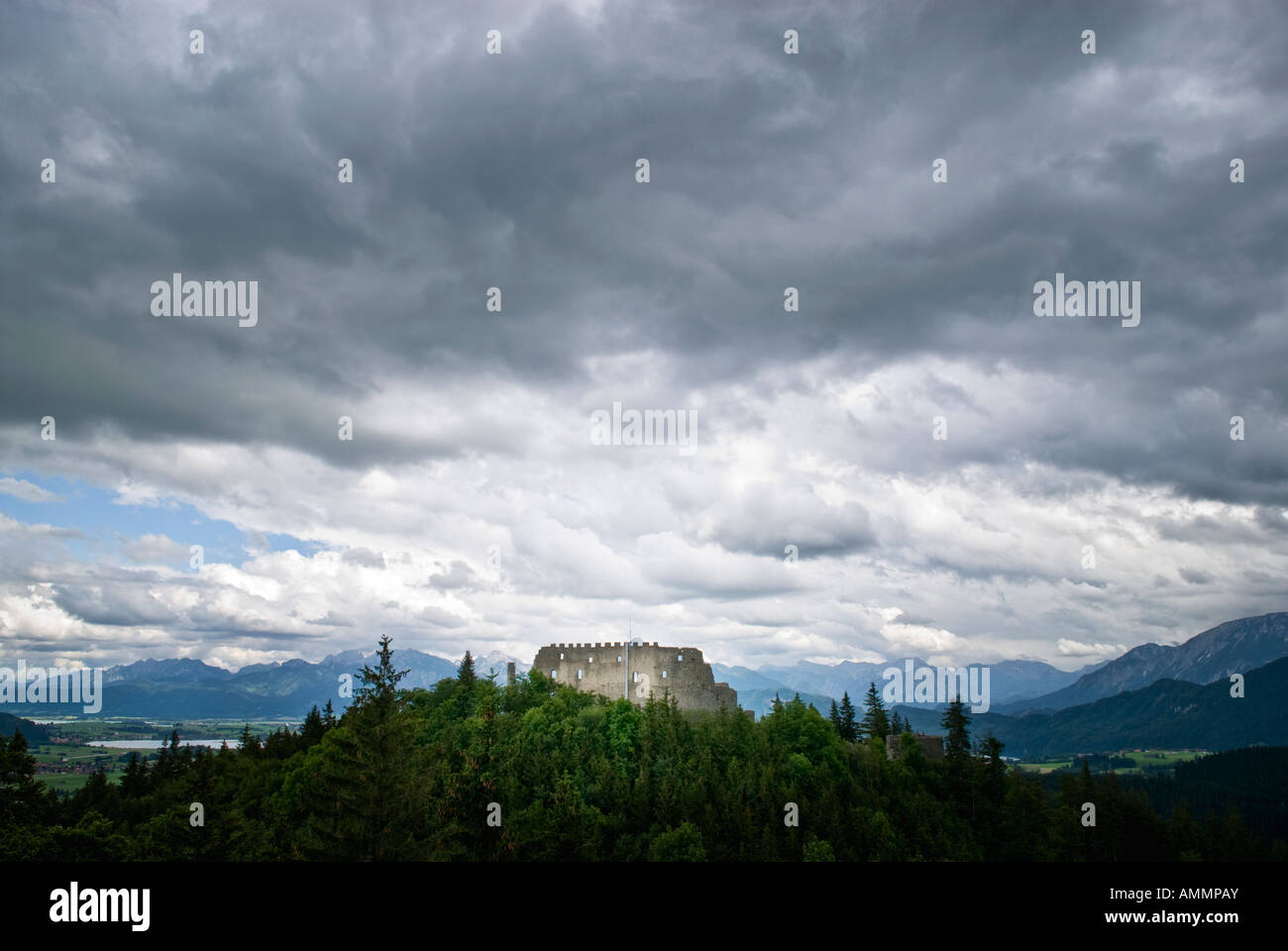 Stormy skies over the ruin of Burg Eisenberg castle, Eisenberg, Ostallgäu, Bavaria, Germany - Stock Image