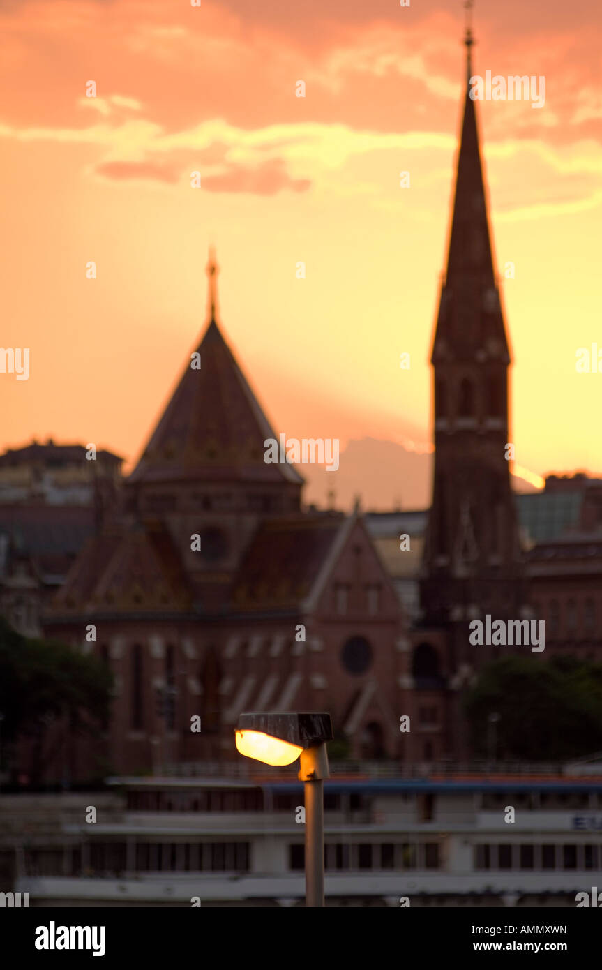 Streetlight and Buda skyline at sunset, Budapest, Hungary. - Stock Image