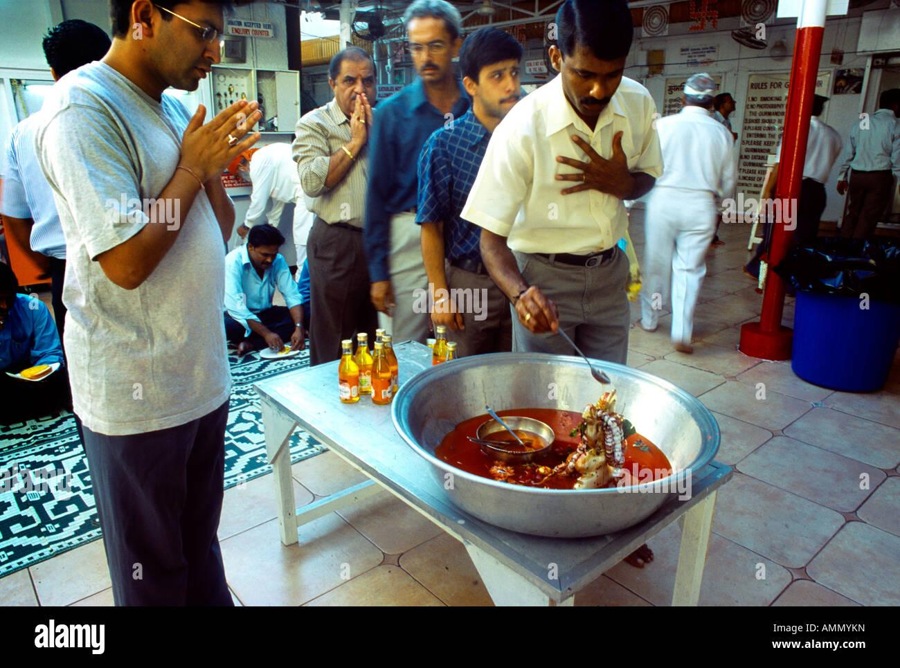 Dubai Uae Bur Dubai Man Bathing Hanuman And Praying At