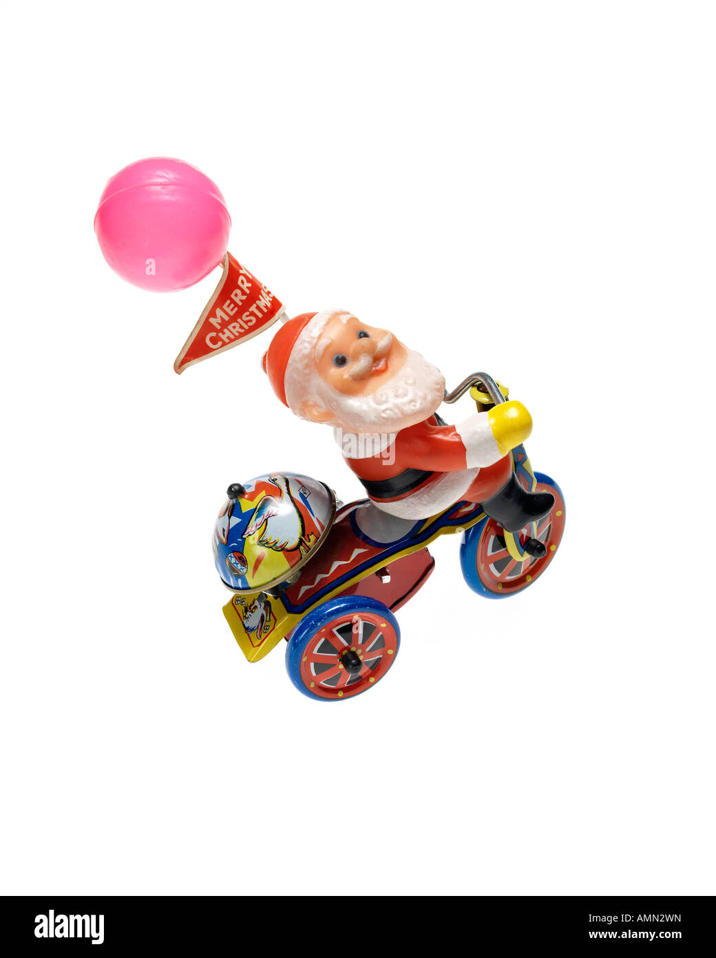 Santa Claus metal wind up toy on white background - Stock Image