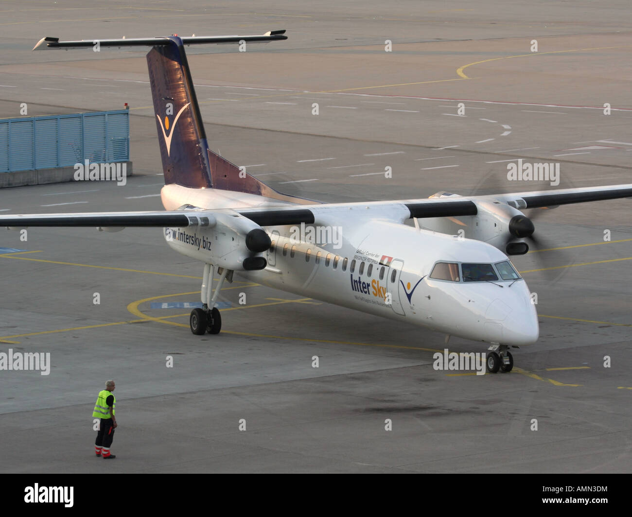 Short haul air travel. InterSky Bombardier Dash 8-Q300 turboprop passenger plane starting up at Cologne/Bonn Airport Stock Photo